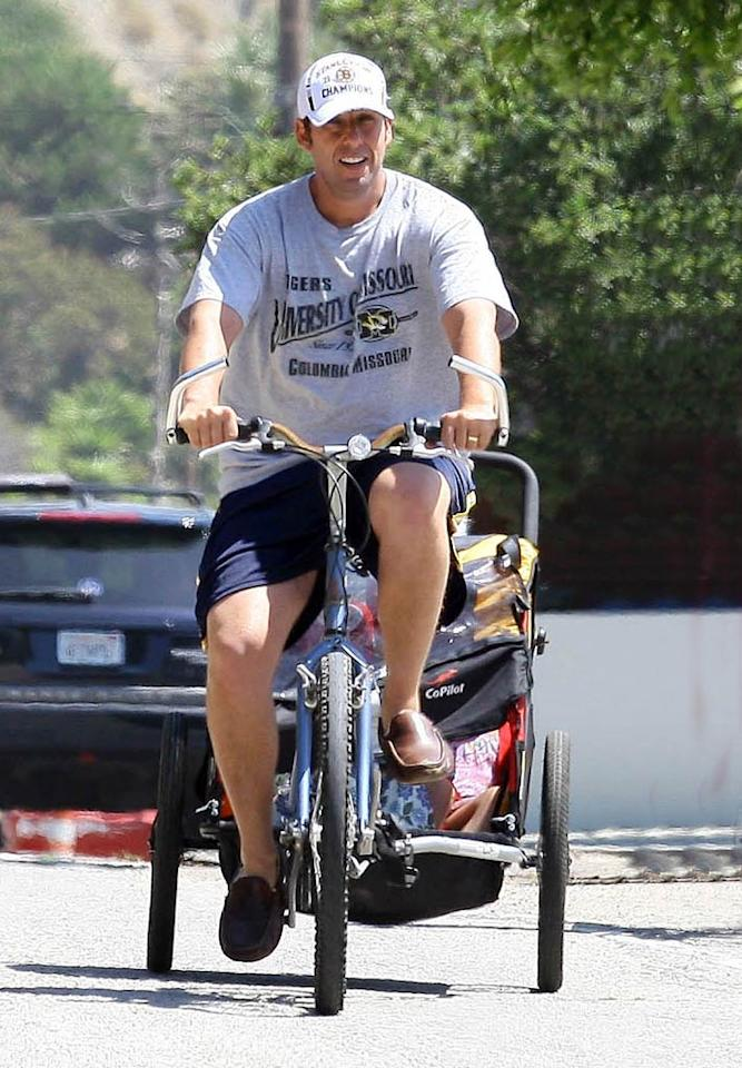 "Funny man Adam Sandler was also snapped in Malibu pulling his kiddies along behind him as he got in some exercise ... and fresh air. BP/Headlinephoto/<a href=""http://www.splashnewsonline.com"" target=""new"">Splash News</a> - September 5, 2011"