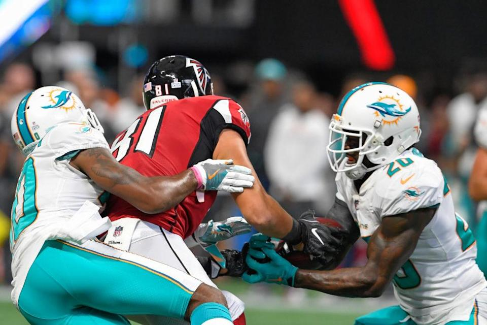 Oct 15, 2017; Atlanta, GA, USA; Atlanta Falcons tight end Austin Hooper (81) is hit by Miami Dolphins cornerback Cordrea Tankersley (30) causing an interception by Dolphins free safety Reshad Jones (20) in the last minute of the game during the second half at Mercedes-Benz Stadium. Mandatory Credit: Dale Zanine-USA TODAY Sports