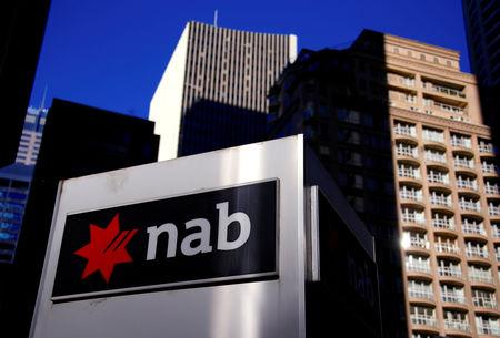 FILE PHOTO: The logo of the National Australia Bank is displayed outside their headquarters building in central Sydney, Australia August 4, 2017. REUTERS/David Gray/File Photo