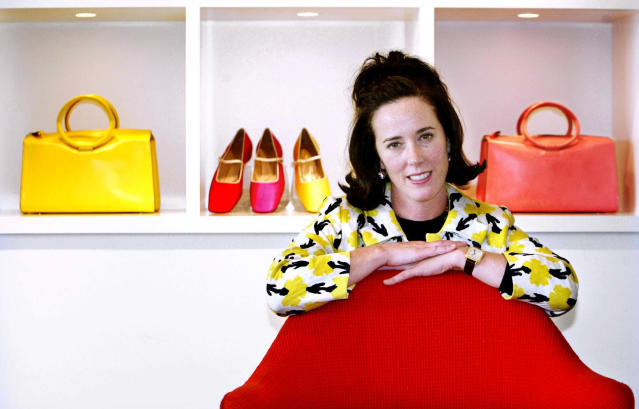 Designer Kate Spade poses with handbags and shoes from her collection in New York. Law enforcement officials said Spade was found dead in her apartment in an apparent suicide on Tuesday, June 5, 2018. (AP Photo/Bebeto Matthews, File)