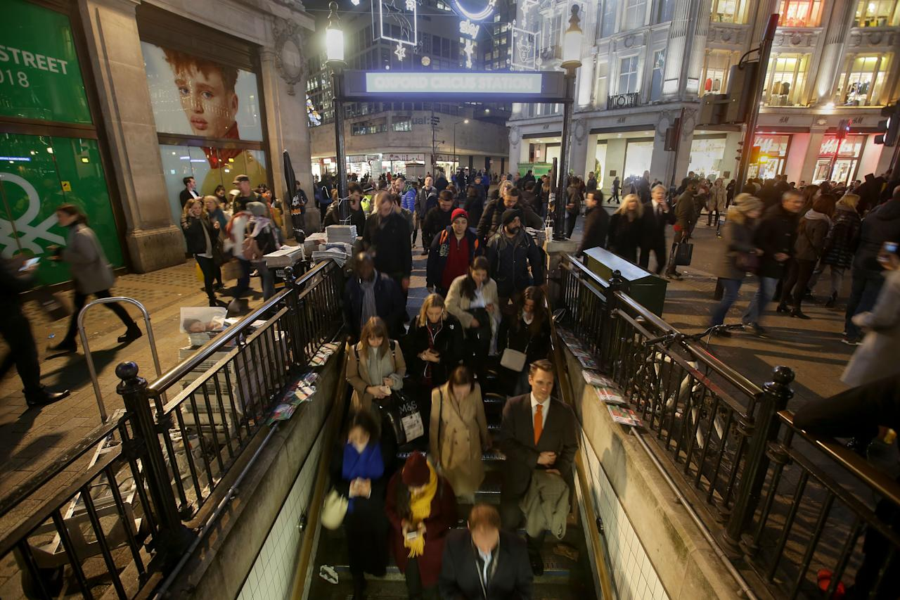 <p>Commuters descend the stairs to catch the tube at Oxford Circus Station in central London on Nov. 24, 2017, following an incident. (Photo: Daniel Leal-Olivas/AFP/Getty Images) </p>