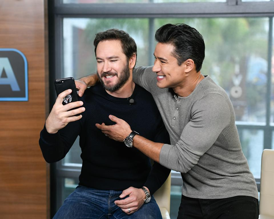 """UNIVERSAL CITY, CALIFORNIA - JANUARY 16: Mark-Paul Gosselaar and Mario Lopez visit """"Extra"""" at Universal Studios Hollywood on January 16, 2019 in Universal City, California. (Photo by Noel Vasquez/Getty Images)"""
