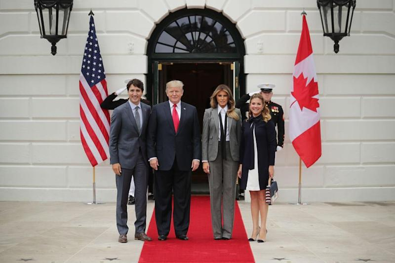 Melania Trump wears a suit to welcome the Canadian Prime Minister. Photo: Getty