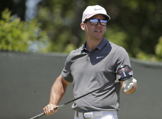 Paul Casey of England, watches his shot off the fourth tee during the final round of the U.S. Open Golf Championship, Sunday, June 17, 2018, in Southampton, N.Y. (AP Photo/Julio Cortez)