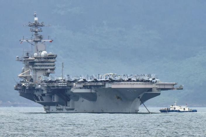 FILE PHOTO: The USS Theodore Roosevelt (CVN-71) is pictured as it enters the port in Da Nang, Vietnam