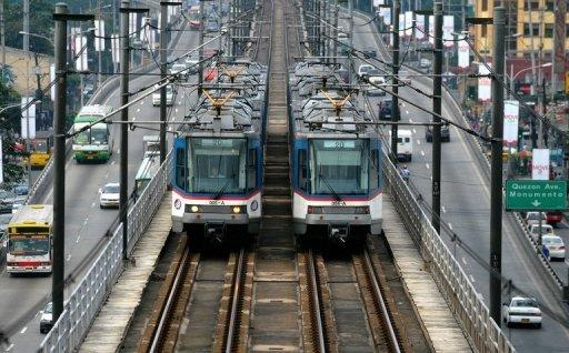 Two Metro Rail Transit trains pass each other in Manila