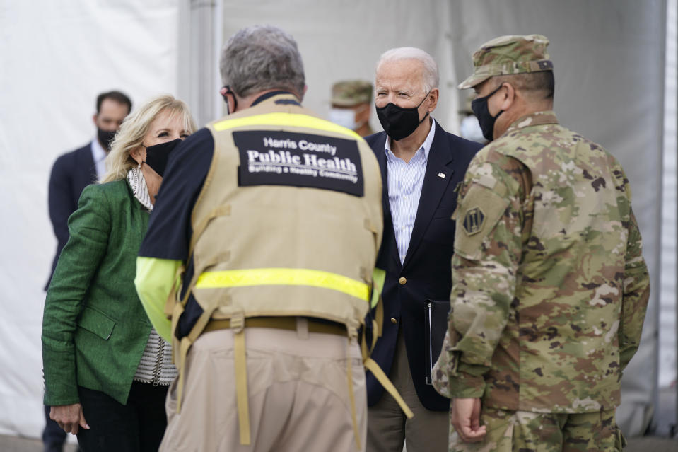President Joe Biden and first lady Jill Biden arrive at a FEMA COVID-19 mass vaccination site at NRG Stadium, Friday, Feb. 26, 2021, in Houston. (AP Photo/Patrick Semansky)