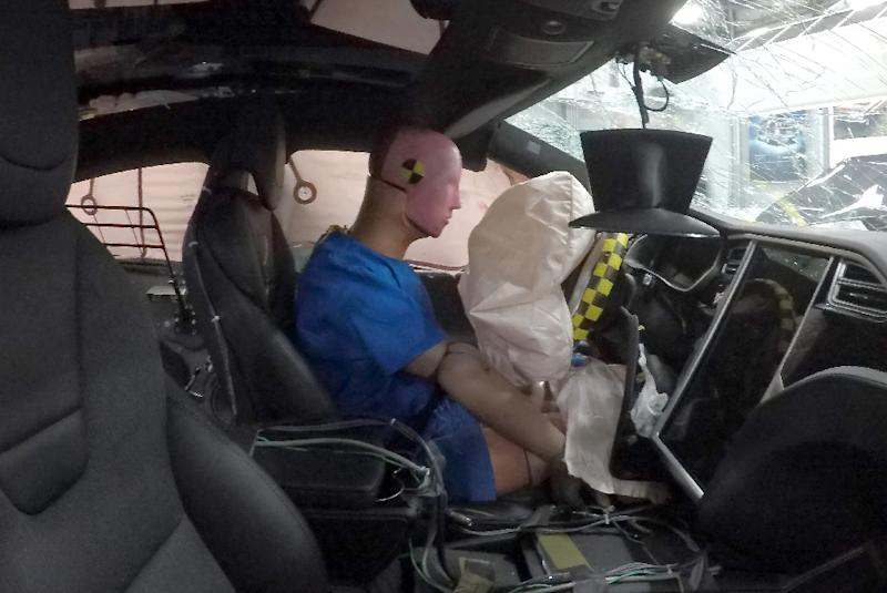 A technology-packed, 180-pound (80 kg) crash test dummy sends a vast array of data from its sensors to show how he fared in the crash (AFP Photo/Anne LEBRETON)