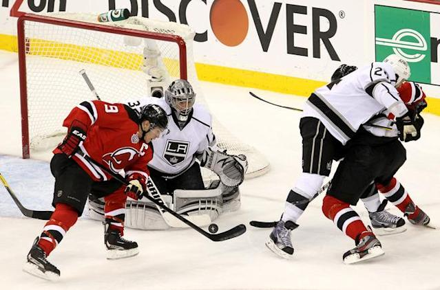 NEWARK, NJ - JUNE 02: Zach Parise #9 of the New Jersey Devils goes for a loose puck in front of Jonathan Quick #32 of the Los Angeles Kings during Game Two of the 2012 NHL Stanley Cup Final at the Prudential Center on June 2, 2012 in Newark, New Jersey. (Photo by Jim McIsaac/Getty Images)