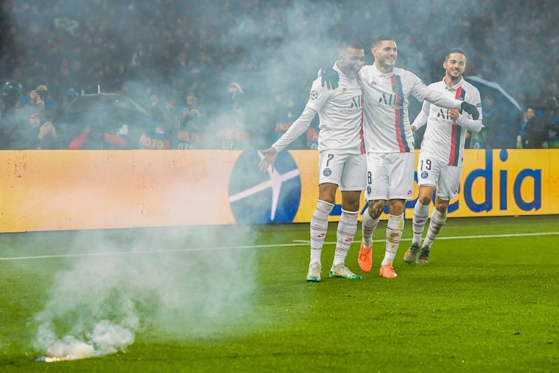 Kylian Mbappé (7) celebrated his goal in PSG's victory with teammates ... and fireworks. (Photo by ANP Sport via Getty Images)