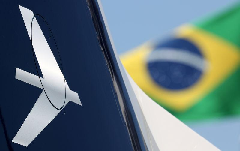 The Embraer logo is seen during the LABACE fair in Sao Paulo