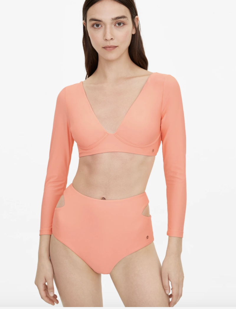 Pomelo open back long sleeve swim top - Coral, S$29. PHOTO: Pomelo
