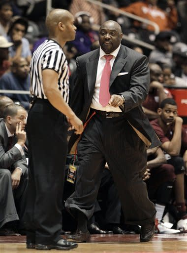 Texas Southern head coach Darrell Asberry, right, shouts at an official looking for a foul call in the first half of an NCAA college basketball game against Mississippi Valley State for the championship of the Southwestern Athletic Conference tournament, Saturday, March 10, 2012, in Garland, Texas. (AP Photo/Tony Gutierrez)