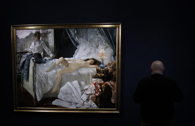 """A man looks at """"Rolla"""", a painting by Henri Gervex as part of the exhibition """" Degas and the Nude"""" in Paris, Monday, March 12, 2012. This exhibition has been organised by the Musee d' Orsay and the Museum of Fine Arts, Boston, and takes place from March 13 to July 1, 2012. (AP Photo/Christophe Ena)"""
