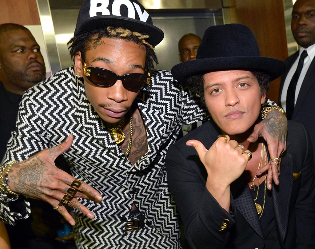 LOS ANGELES, CA - FEBRUARY 10:  Rapper Wiz Khalifa (L) and singer Bruno Mars attend the 55th Annual GRAMMY Awards at STAPLES Center on February 10, 2013 in Los Angeles, California.  (Photo by Rick Diamond/WireImage)