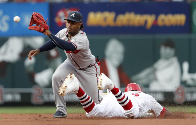 St. Louis Cardinals' Dexter Fowler, right, is safe at second for a stolen base ahead of the tag from Atlanta Braves second baseman Ozzie Albies during the first inning of a baseball game Sunday, May 26, 2019, in St. Louis. (AP Photo/Jeff Roberson)
