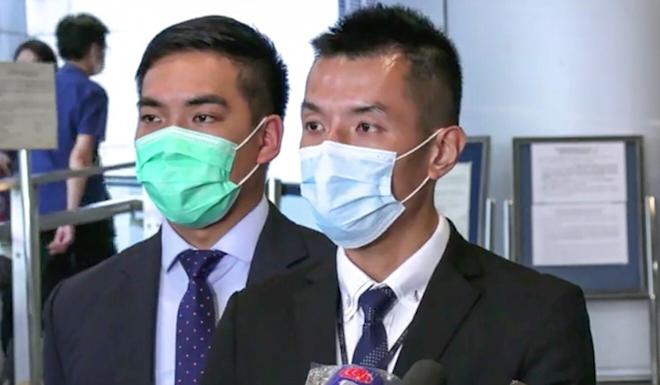 Chief Inspector Hui Hong-kit (right), of the Hong Kong Island regional crime unit, briefs the media on recent fraud arrests. Photo: Hong Kong Police