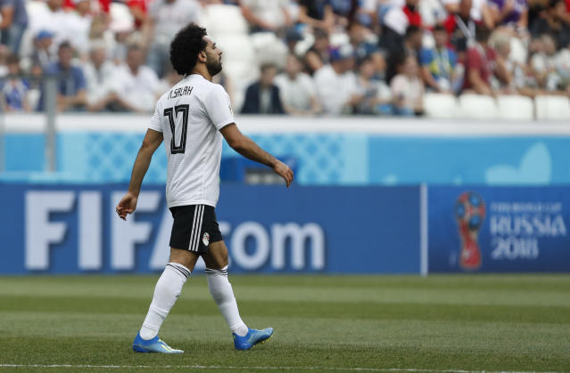 Egypt's Mohamed Salah walks on the pitch during the group A match between Saudi Arabia and Egypt at the 2018 soccer World Cup at the Volgograd Arena in Volgograd, Russia, Monday, June 25, 2018. (AP Photo/Darko Vojinovic)