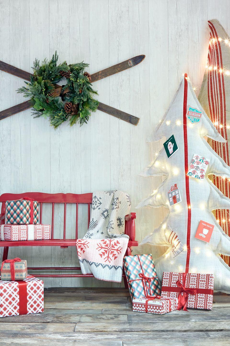 """<p>Hang old wooden skis (available on eBay) in an X, then spruce up a display with a festive wreath.</p><p><a class=""""link rapid-noclick-resp"""" href=""""https://www.amazon.com/s/ref=nb_sb_noss_2?url=search-alias%3Dgarden&field-keywords=christmas+wreath&rh=n%3A1055398%2Ck%3Achristmas+wreath&tag=syn-yahoo-20&ascsubtag=%5Bartid%7C10050.g.1247%5Bsrc%7Cyahoo-us"""" rel=""""nofollow noopener"""" target=""""_blank"""" data-ylk=""""slk:SHOP CHRISTMAS WREATHS"""">SHOP CHRISTMAS WREATHS</a> </p>"""