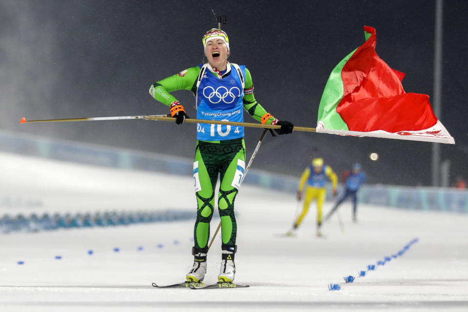 Darya Domracheva, of Belarus, skis across the finish line for the gold medal during the Women's 4×6-km Biathlon Relay at the 2018 Winter Olympics in PyeongChang, South Korea, on Feb. 22, 2018. (AP Photo/Andrew Medichini)