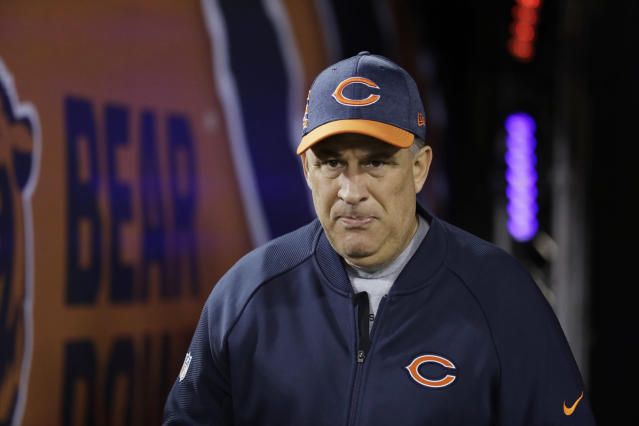 FILE - In this Dec. 9, 2018, file photo, Chicago Bears defensive coordinator Vic Fangio walks to the field before an NFL football game against the Los Angeles Rams, in Chicago. A person with knowledge of the decision tells The Associated Press that Denver Broncos general manager John Elway has decided on Chicago Bears defensive coordinator Vic Fangio as his new head coach. The person spoke on condition of anonymity Wednesday, Jan. 9, 2019, because the team hadn't announced the hiring. (AP Photo/Nam Y. Huh, File)