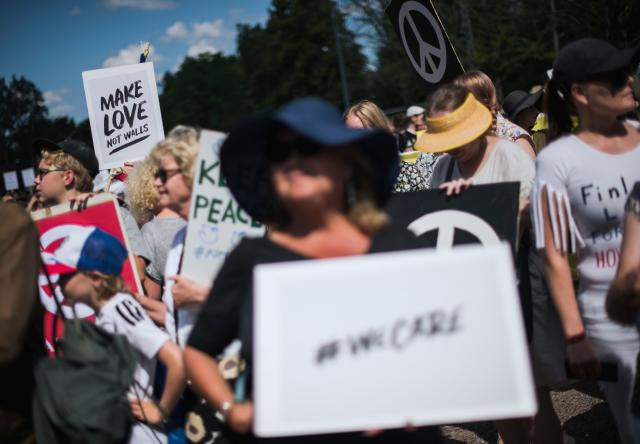"<p>People hold placards and banners during the so-called ""Helsinki Calling"" march towards the Senate Square to defend the human rights, freedom of speech and democracy on July 15, 2018, ahead of the arrival of President for a summit with his Russian counterpart in the Finnish capital Helsinki. (Photo: Jonathan Nackstrand/AFP/Getty Images) </p>"