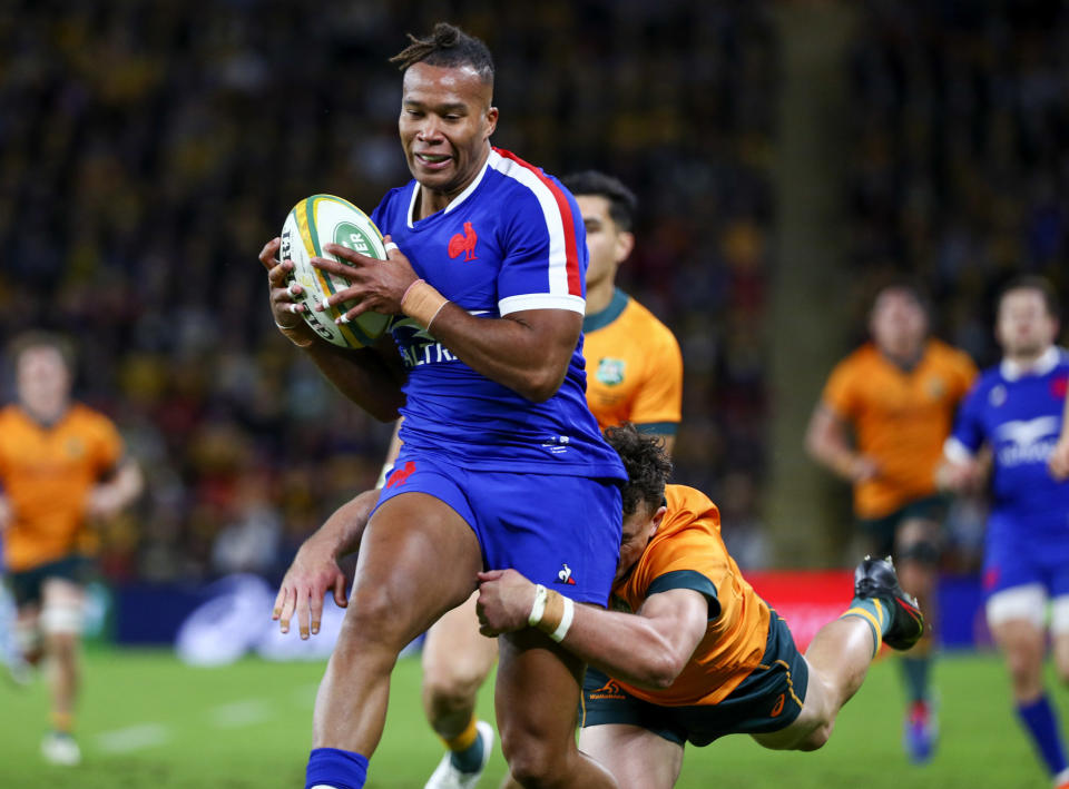 France's Teddy Thomas, left, is tackled by Australia's Tom Banks during the third rugby international between France and Australia at Suncorp Stadium in Brisbane, Australia, Saturday, July 17, 2021. (AP Photo/Tertius Pickard)