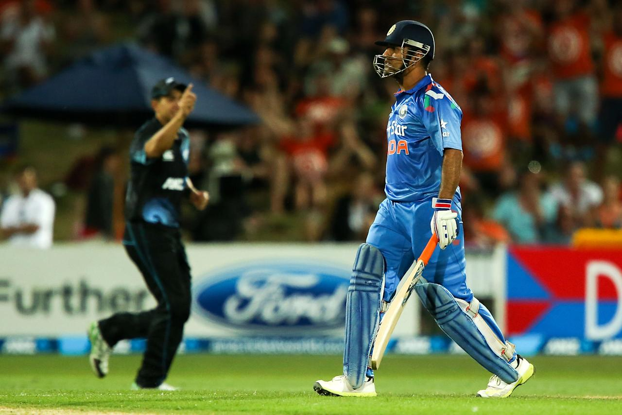 NAPIER, NEW ZEALAND - JANUARY 19:  MS Dhoni of India leaves the field after being dismissed during the first One Day International match between New Zealand and India at McLean Park on January 19, 2014 in Napier, New Zealand.  (Photo by Hagen Hopkins/Getty Images)
