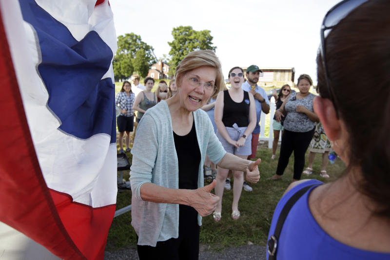 "FILE - In this July 8, 2018, file photo, Sen. Elizabeth Warren, D-Mass., greets people following a town hall event at Belkin Family Lookout Farm, in Natick, Mass. She took the DNA test President Donald Trump urged. She's hitting back in personal terms, calling him ""creepy"" on Twitter, in real time. And she's not backing down. When it comes to challenging the man who redefined the rules of American political combat, Warren in some ways is doing it Trump's way. She's getting some backlash from Native Americans and grumbling from Democrats who'd rather be talking about toppling Congress' Republican majorities in the midterm elections three weeks away. (AP Photo/Steven Senne, File)"