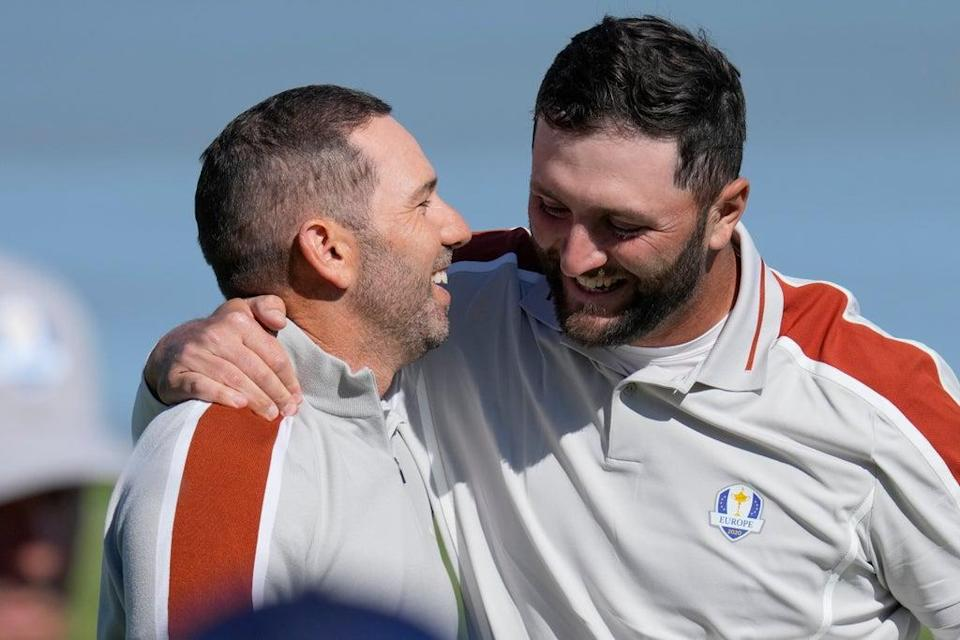 Sergio Garcia (left) and Jon Rahm celebrate after winning their foursomes match on day two of the Ryder Cup (Ashley Landis/AP) (AP)