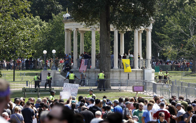 """<p>Organizers stand on the bandstand on Boston Common during a """"Free Speech"""" rally staged by conservative activists, Saturday, Aug. 19, 2017, in Boston, Mass. Counterprotesters stand along barricades ringing the bandstand. (Photo: Michael Dwyer/AP) </p>"""