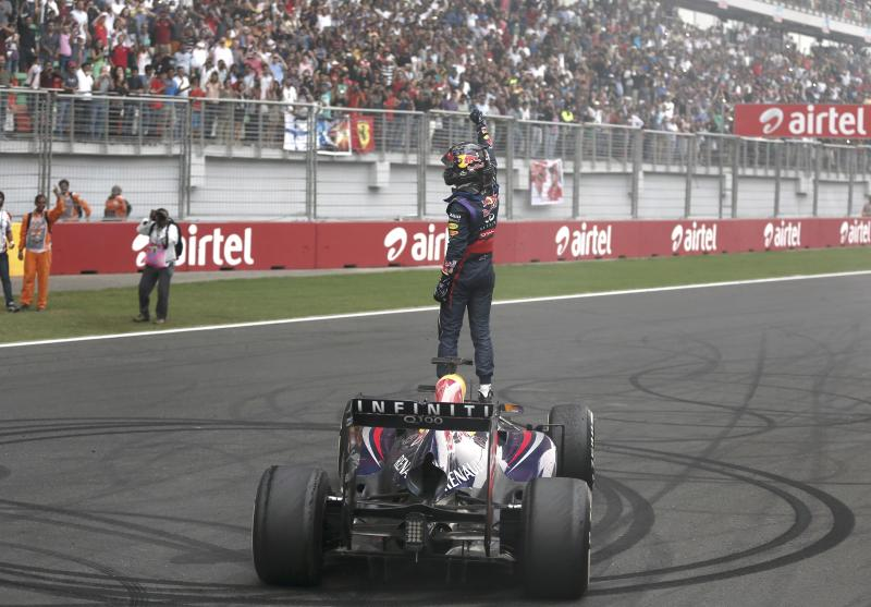 Red Bull Formula One driver Sebastian Vettel of Germany celebrates atop his car after winning the Indian F1 Grand Prix at the Buddh International Circuit in Greater Noida, on the outskirts of New Delhi, October 27, 2013. Vettel became Formula One's youngest four-times world champion on Sunday after winning the Indian Grand Prix for Red Bull. Red Bull also took the constructors' championship for the fourth year in a row. The victory from pole position was the 26-year-old's sixth in a row and completed a hat-trick of wins in India where no other driver has ever won since the race made its debut in 2011. REUTERS/Adnan Abidi (INDIA - Tags: SPORT MOTORSPORT F1 TPX IMAGES OF THE DAY)