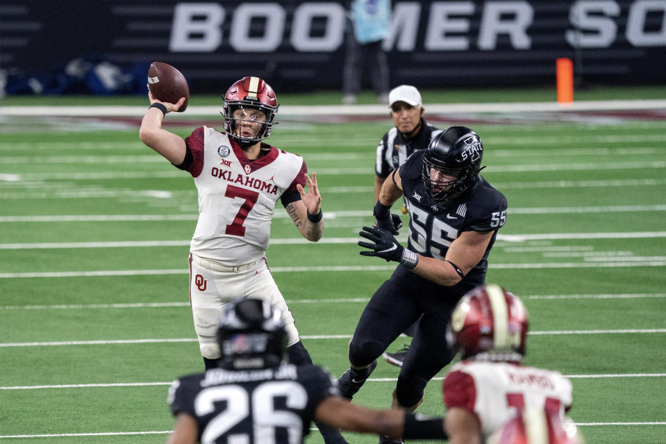 Oklahoma quarterback Spencer Rattler (7) throws against Iowa State during the first half of the the Big 12 Conference championship NCAA college football game, Saturday, Dec. 19, 2020, in Arlington, Texas. (AP Photo/Jeffrey McWhorter)