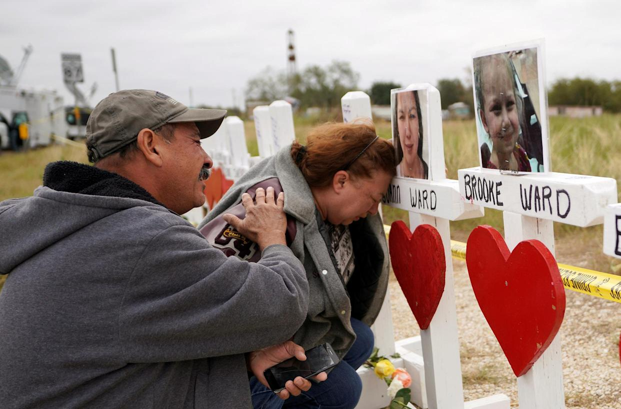 Lorenzo Flores, left, and Terrie Smith weep in remembrance of those killed in the shooting at the First Baptist Church of Sutherland Springs, Texas, Nov. 9, 2017. (Photo: Rick Wilking/Reuters)