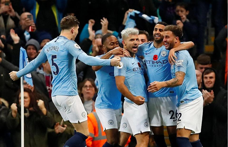 Manchester City's Sergio Aguero (center) celebrates scoring what ended up being the winning goal against Manchester United. (Reuters/Jason Cairnduff(
