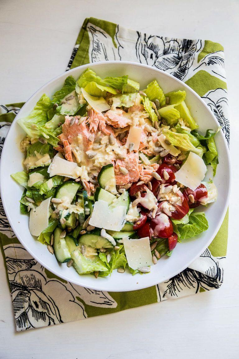 """<p>Another super easy method for preparing salmon: Cook it in a foil packet on the grill. Remove the fish when it flakes easily with a fork and is just barely cooked through. Once it cools, serve over salad with homemade caesar dressing.</p><p><strong>Get the recipe from <a href=""""https://www.thepioneerwoman.com/food-cooking/recipes/a94507/grilled-salmon-caesar-salad/"""" rel=""""nofollow noopener"""" target=""""_blank"""" data-ylk=""""slk:Natalie Perry"""" class=""""link rapid-noclick-resp"""">Natalie Perry</a>. </strong> </p>"""