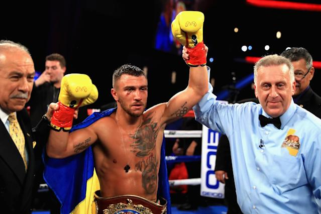"Vasyl Lomachenko reacts after defeating <a class=""link rapid-noclick-resp"" href=""/olympics/rio-2016/a/1152098/"" data-ylk=""slk:Miguel Marriaga"">Miguel Marriaga</a> by TKO in the seventh round. (Getty)"