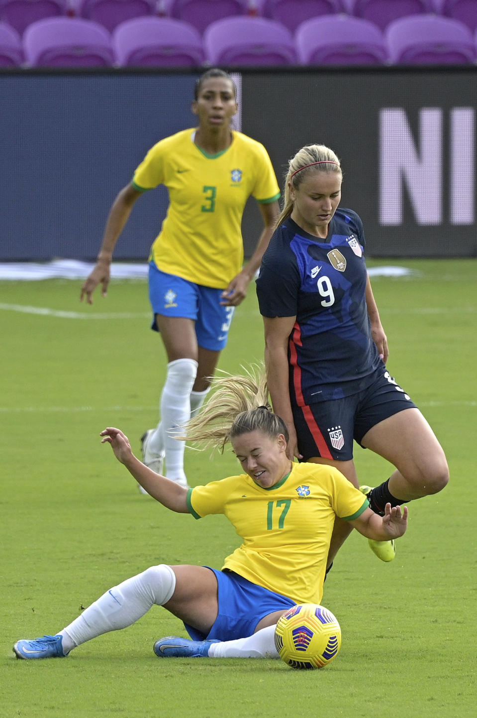 Brazil midfielder Andressinha (17) and United States midfielder Lindsey Horan (9) collide while competing for a ball during the first half of a SheBelieves Cup women's soccer match, Sunday, Feb. 21, 2021, in Orlando, Fla. (AP Photo/Phelan M. Ebenhack)