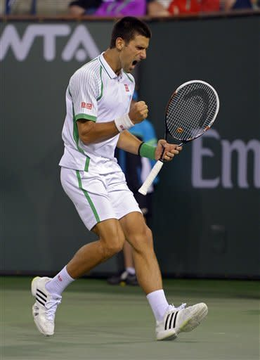 Novak Djokovic, of Serbia, celebrates after winning a game over Fabio Fognini, of Italy, during their match at the BNP Paribas Open tennis tournament, Sunday, March 10, 2013, in Indian Wells, Calif. (AP Photo/Mark J. Terrill)