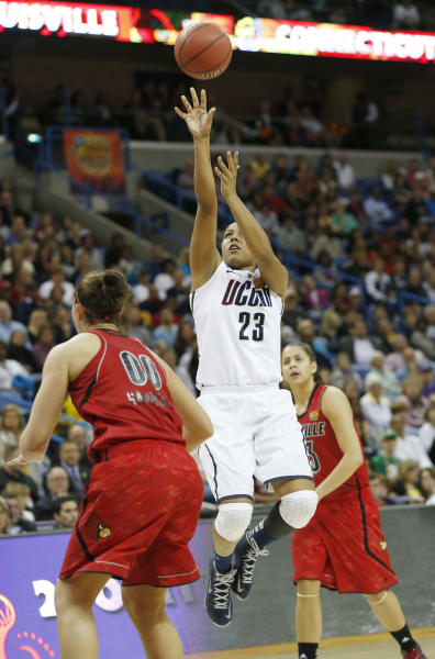 Connecticut forward Kaleena Mosqueda-Lewis (23) takes a shot against Louisville forward Sara Hammond (00) during first half of the national championship game of the women's Final Four of the NCAA college basketball tournament, Tuesday, April 9, 2013, in New Orleans. (AP Photo/Dave Martin)