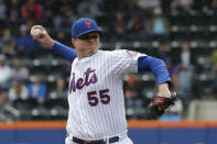 New York Mets pitcher Corey Oswalt works in the first inning of a baseball game against the Philadelphia Phillies, Sunday, Sept. 9, 2018, in New York. (AP Photo/Mark Lennihan)