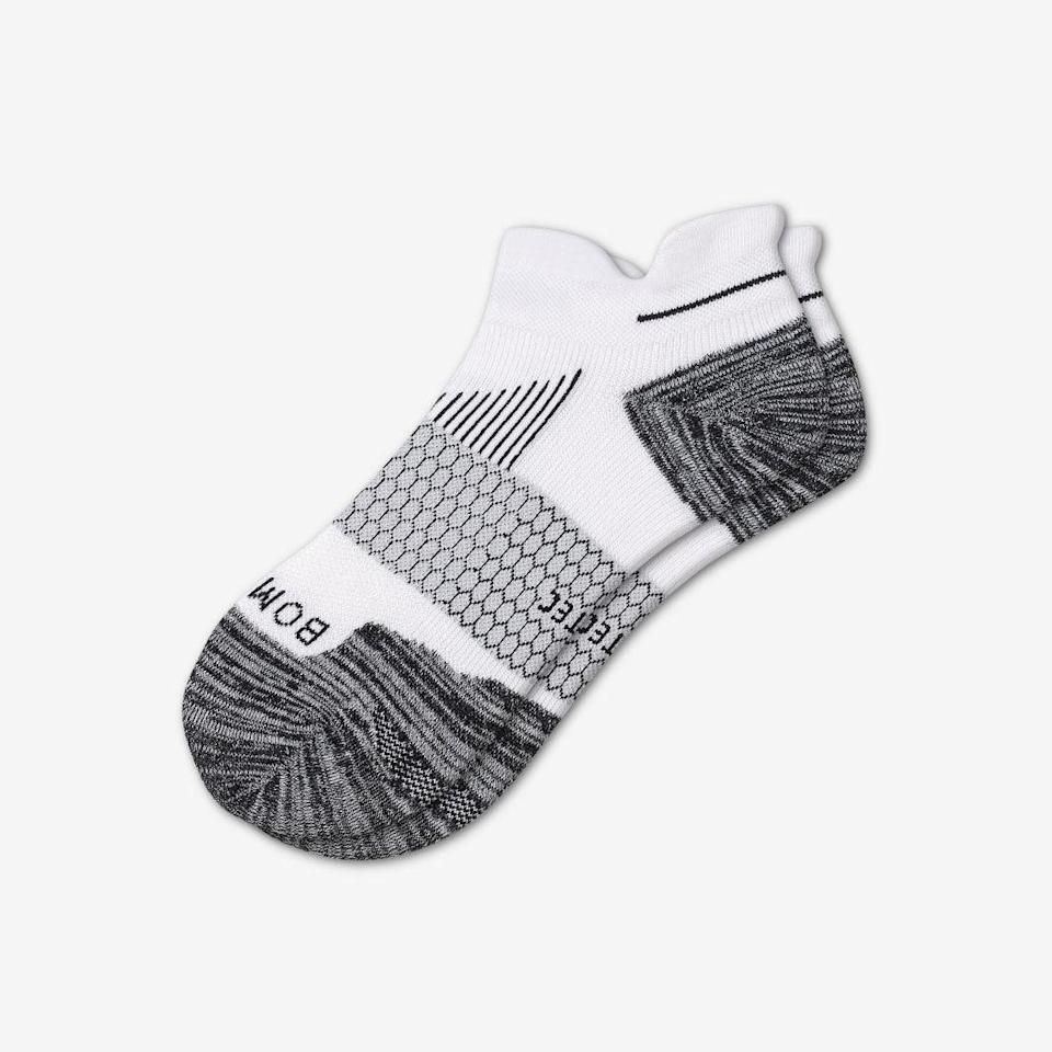 "<p><strong>Bombas</strong></p><p>bombas.com</p><p><strong>$16.00</strong></p><p><a href=""https://bombas.com/products/womens-performance-running-ankle-sock"" rel=""nofollow noopener"" target=""_blank"" data-ylk=""slk:SHOP WOMEN'S"" class=""link rapid-noclick-resp"">SHOP WOMEN'S</a></p><p><a class=""link rapid-noclick-resp"" href=""https://bombas.com/products/mens-performance-running-ankle-sock"" rel=""nofollow noopener"" target=""_blank"" data-ylk=""slk:SHOP MEN'S"">SHOP MEN'S</a></p><p>Bombas socks offer<strong> exceptional cushioning without feeling too bulky and our experts find they hold their shape well </strong>with repeated use. The brand's signature Hex Tec construction makes the sock breathable and improves moisture wicking, while strategically placed airflow venting and cushioning prevent blister-causing hot spots. Left/right contouring and a seamless toe help provide a fit runners rave about without risking irritation.</p><p>The socks are made with a poly/cotton blend, but Bombas also started producing <a href=""https://bombas.com/products/womens-performance-running-merino-ankle-socks"" rel=""nofollow noopener"" target=""_blank"" data-ylk=""slk:this sock in a Merino wool blend"" class=""link rapid-noclick-resp"">this sock in a Merino wool blend</a>, which is quickly becoming as beloved as its predecessor.<br></p>"