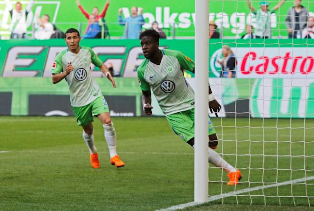 Soccer Football - Bundesliga - VfL Wolfsburg v FC Cologne - Volkswagen Arena, Wolfsburg, Germany - May 12, 2018 Wolfsburg's Divock Origi celebrates scoring their second goal REUTERS/Wolfgang Rattay DFL RULES TO LIMIT THE ONLINE USAGE DURING MATCH TIME TO 15 PICTURES PER GAME. IMAGE SEQUENCES TO SIMULATE VIDEO IS NOT ALLOWED AT ANY TIME. FOR FURTHER QUERIES PLEASE CONTACT DFL DIRECTLY AT + 49 69 650050