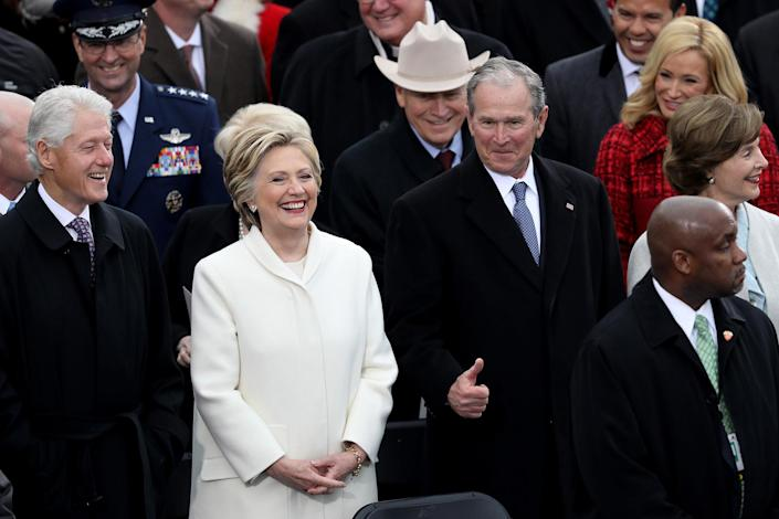 <p>Former President Bill Clinton (L), former Democratic presidential nominee Hillary Clinton and former President George W. Bush stand on the West Front of the U.S. Capitol on January 20, 2017 in Washington, DC. (Photo: Joe Raedle/Getty Images) </p>