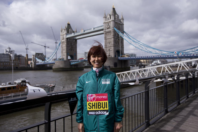 Japanese marathon runner Yoko Shibui poses for photographs during a media opportunity for the London Marathon backdropped by Tower Bridge in London, Thursday, April 18, 2013. The London Marathon will go ahead on Sunday despite security fears in the wake of the bomb blasts in the Boston race that killed at least three runners and injured many more. (AP Photo/Matt Dunham)