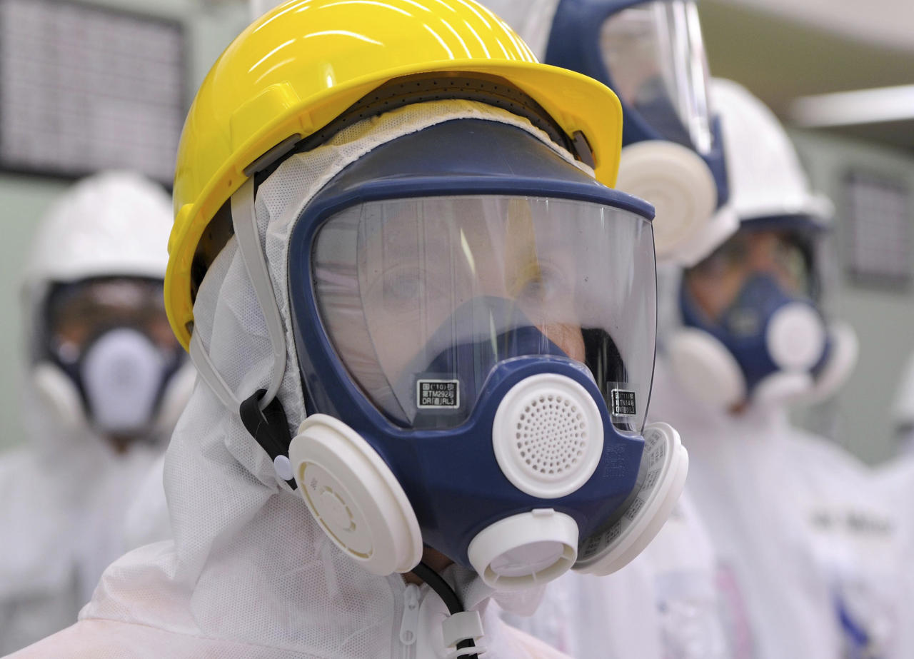 U.S. Ambassador to Japan Caroline Kennedy wearing a yellow helmet and a mask inspects the central control room for the Unit One and Unit Two reactors of the tsunami-crippled Fukushima Dai-ichi nuclear power plant, operated by Japan's Tokyo Electric Power Co. (TEPCO), in Okuma, Fukushima Prefecture, northeastern Japan, Wednesday, May 14, 2014. Kennedy toured the Fukushima Dai-ichi plant for about three hours Wednesday. (AP Photo/Toru Yamanaka, Pool)