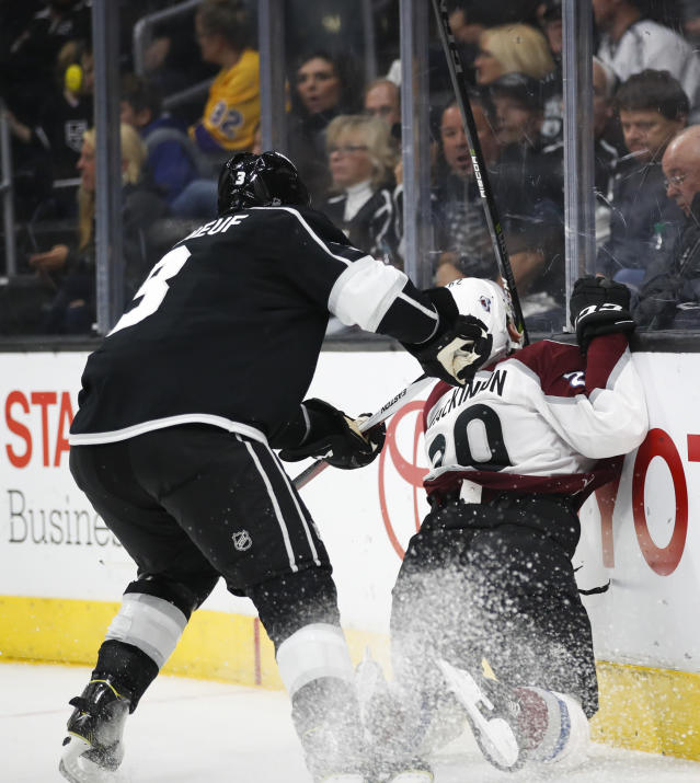 Colorado Avalanche's Nathan MacKinnon, right, is shoved by Los Angeles Kings' Dion Phaneuf during the first period of an NHL hockey game Monday, April 2, 2018, in Los Angeles. (AP Photo/Jae C. Hong)
