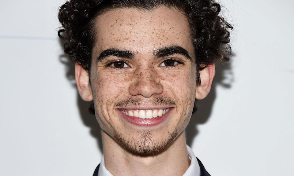 """Disney star Cameron Boyce tragically <a href=""""https://uk.news.yahoo.com/disney-star-cameron-boyce-dies-in-sleep-age-20-092920525.html"""" data-ylk=""""slk:died in his sleep aged just 20;outcm:mb_qualified_link;_E:mb_qualified_link;ct:story;"""" class=""""link rapid-noclick-resp yahoo-link"""">died in his sleep aged just 20</a> following an epileptic seizure. Before his death, he'd featured in Disney Channel series <em>Jessie</em> and in the three <em>Descendants</em> movies. Many celebrities paid tribute to Boyce, including former First Lady Michelle Obama who had met the actor in 2014. (Photo by Amanda Edwards/WireImage)"""