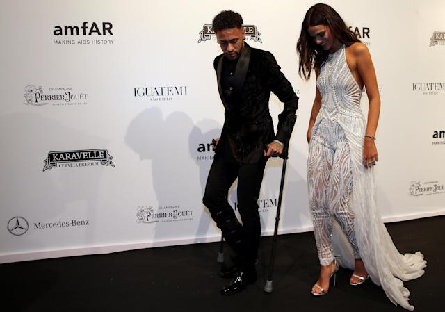 Soccer player Neymar and his girlfriend Bruna Marquezine arrive at the eighth annual amfAR Gala Sao Paulo in Sao Paulo, Brazil April 13, 2018. REUTERS/Paulo Whitaker TPX IMAGES OF THE DAY