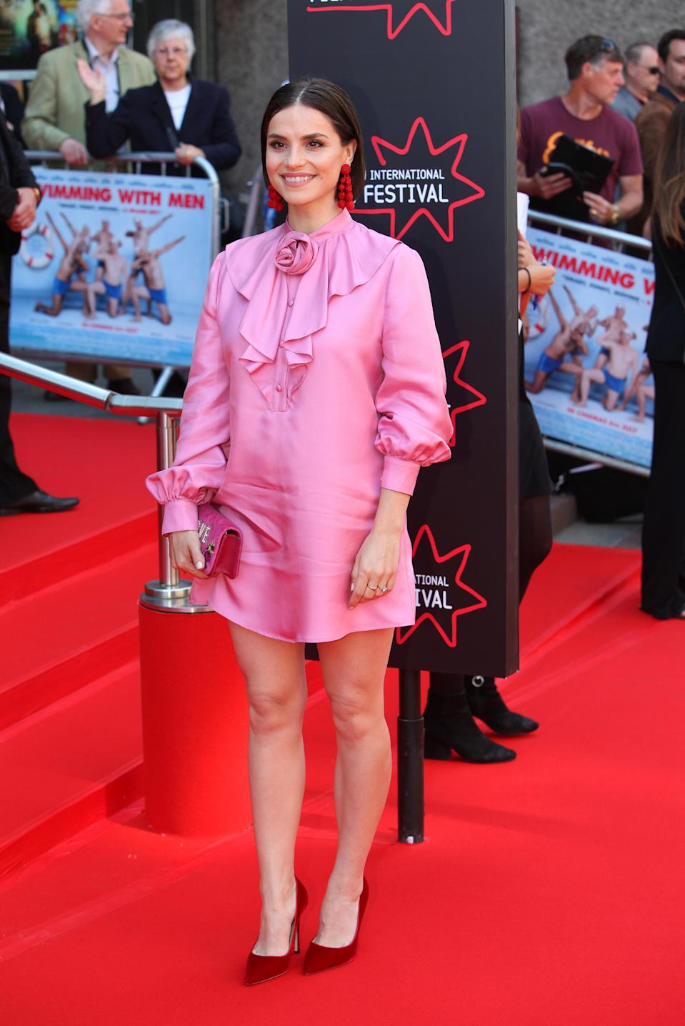 <p>Charlotte Riley proved that pink and red is the ultimate colour combo at the premiere of 'Swimming with Men' at the 72nd Edinburgh International Film Festival on 1 July. [Photo: Getty] </p>